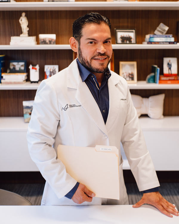 Dr. Edgar Macias of Macias Dermatology in lab coat